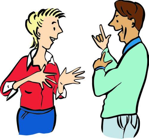 zwei Menschen unterhalten sich in Gebärdensprache